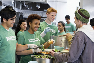 volunteers working in soup kitchen web