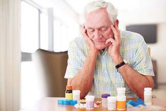senior man confused about medications web