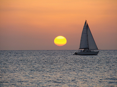 sunset sailing ship web